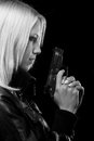 Beautiful girl with gun isolated on black background Royalty Free Stock Photo