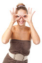 Beautiful girl hamming and shows glasses hands Stock Photo