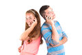 Beautiful girl and handsome boy calling back to back Stock Image