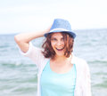 Beautiful girl in a hat on a background of the sea in soft focu focus Stock Photography