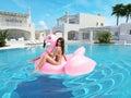 Beautiful girl having fun with pink flamingo float. 3d rendering