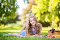 Beautiful girl having a picnic in park. Royalty Free Stock Photo
