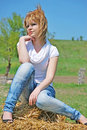 Beautiful girl on a hay bale Royalty Free Stock Photo