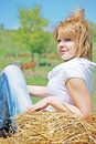 Beautiful girl on a hay bale Stock Image