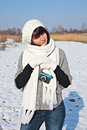 Beautiful girl with her camera in winter a young female photographer walking a Royalty Free Stock Photos