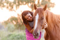 Beautiful girl and her handsome horse a senior portrait taken during sunset Royalty Free Stock Image