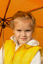 Beautiful girl hiding under an umbrella in the park Stock Photos