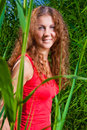 Beautiful girl among high grass Royalty Free Stock Photos