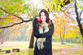 Beautiful girl hold an apple on sunny day in park autumn Royalty Free Stock Image