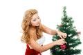 Beautiful girl holding christmas toy isolated white background.