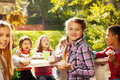 Beautiful girl holding cupcake with her friends Royalty Free Stock Photo
