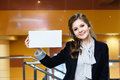 Beautiful girl holding empty white card and smiling Royalty Free Stock Photo