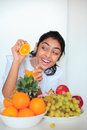 Beautiful girl holding fruits and a measure tape Stock Photo