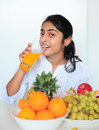 Beautiful girl holding fruits and a measure tape Stock Photos