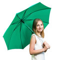 Beautiful girl holding green umbrella isolated on white smiling a background Stock Photography