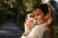 Beautiful girl holding her dog Cavalier King Charles Spaniel Royalty Free Stock Photo