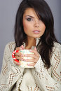 Beautiful girl holding hot tea cup Royalty Free Stock Images