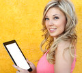 Beautiful girl holding a tablet Stock Images
