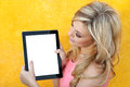 Beautiful girl holding the tablet Royalty Free Stock Images