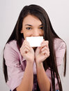 Beautiful girl holding a visit card young woman smiling blank business in front of her mouth Royalty Free Stock Photos