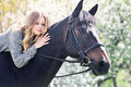Beautiful girl and horse in spring garden Royalty Free Stock Photo