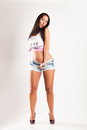 Beautiful girl in hot pants and t shirt and high heels Stock Photography