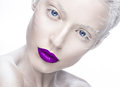 Beautiful girl in the image of albino with purple lips and white eyes. Art beauty face.
