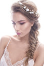 Beautiful girl in image of bride with а wreath of flowers on her hair. Beauty face.