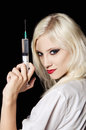 Beautiful girl in the image of nurse with syringe Royalty Free Stock Photography