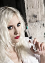 Beautiful girl in the image of nurse with syringe Stock Images