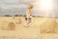 Beautiful girl jumps in sloping field Royalty Free Stock Photo