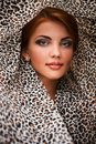 Beautiful girl in kerchief face leopard background Stock Images