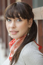 Beautiful girl with kerchief on neck against wooden handrail Stock Photography