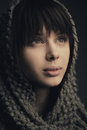 Beautiful girl with knitted scarf portrait Stock Photography