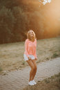 Beautiful girl laughing in a pink jacket and white shorts Royalty Free Stock Photography