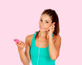 Beautiful girl listening music on her mp listeninig pink background Royalty Free Stock Images