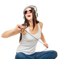 Beautiful girl listens to music through earphones Royalty Free Stock Photos