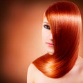Beautiful girl with long red hair Stock Photo
