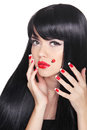 Beautiful girl with Long straight black hair. Red lips. Manicure Royalty Free Stock Photo