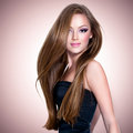 Beautiful girl with long straight hair pretty and attractive face looking at camera Royalty Free Stock Photos