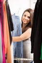 Beautiful girl looking at her wardrobe Royalty Free Stock Photo