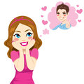 Beautiful girl in love blushing with hands cheeks thinking on the boy of her dreams Stock Images