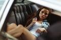 Beautiful girl lying on back seat of car, tinted photo Royalty Free Stock Photo