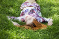 Beautiful girl lying down at grass Royalty Free Stock Image