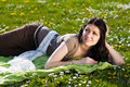 Beautiful girl lying on the grass with flowers Royalty Free Stock Image