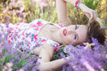 Beautiful girl lying on the lavender field Royalty Free Stock Photo