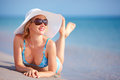Beautiful girl lying in surf on the beach Royalty Free Stock Photos