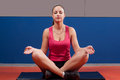 Beautiful girl meditating in the gym after workout Stock Images