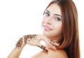 Beautiful girl with mehandi happy smiling have painted fresh applied henna on her hand Royalty Free Stock Photo