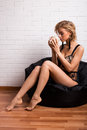 Beautiful girl in the morning with a cup of coffee Royalty Free Stock Photo